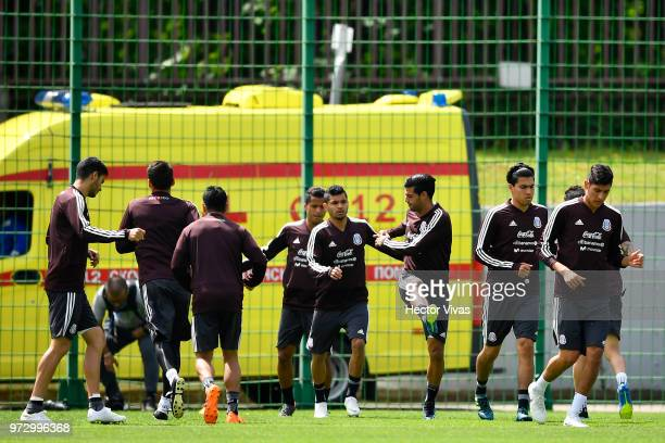 Players of Mexico warm up during a training session at team training base NovogorskDynamo on June 13 2018 in Moscow Russia