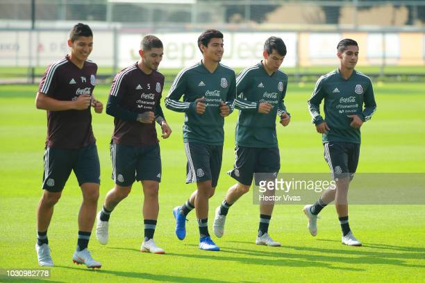 Players of Mexico warm up during Mexico National Team training session ahead of the international friendly match against Uruguay at CAR on September...
