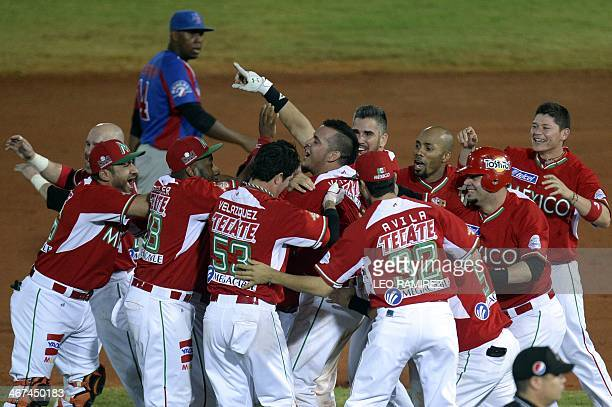 Players of Mexico's Naranjeros de Hermosillo celebrate after defeating Dominican Republic's Tigres de Licey during their 2014 Caribbean baseball...