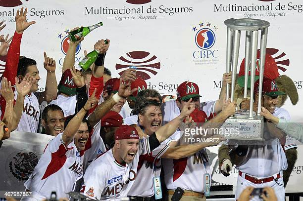 Players of Mexico's Naranjeros de Hermosillo celebrate after winning the 2014 Caribbean baseball series defeating Puerto Rico's Indios de Mayaguez on...