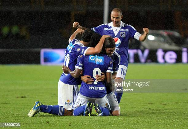 Players of Millonarios celebrate a goal against Cucuta during a match between Millonarios and Cucuta as part of the Liga Postobon 2013 at Nemesio...
