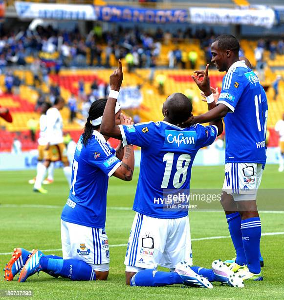 Players of Millonarios celebrate a scored goal during the match between Millonarios and Deportes Tolima as part of Postobon Leguaje II 2013 at...