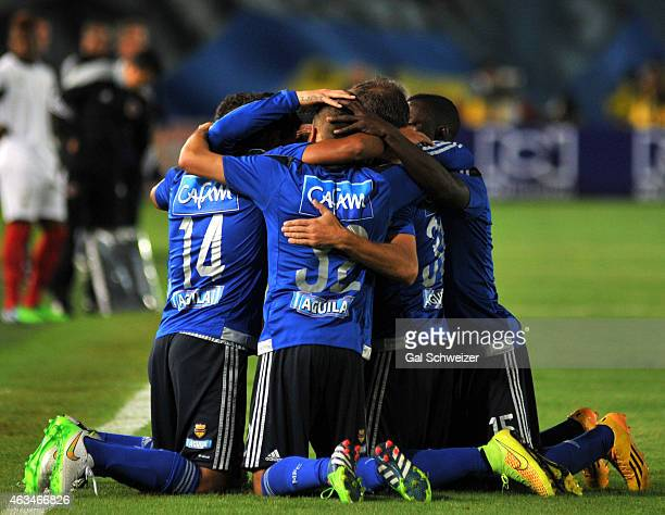 Players of Millonarios celebrate after scoring the first goal of their team during a match between Millonarios and Cucuta at Nemesio Camacho El...