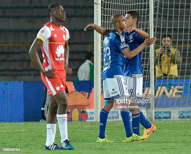 Players of Millonarios celebrate after the match between Millonarios and Independiente Santa Fe as part of round 20 of Liga Aguila II 2015 at Nemesio...