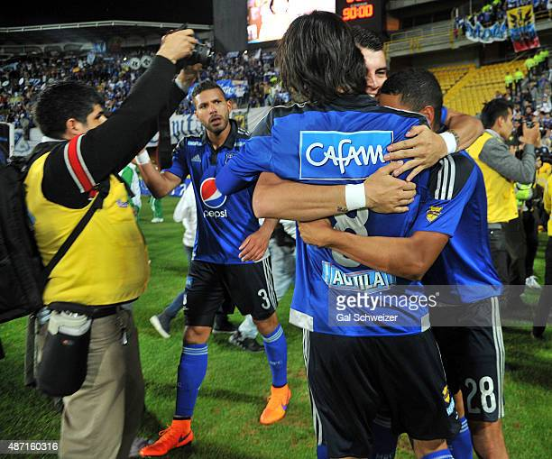 Players of Millonarios celebrate the first goal of his team scored by Federico Insua during a match between Santa Fe and Millonarios as part of 10th...