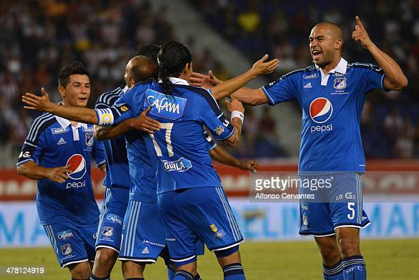 Players of Millonarios celebrate the opening goal during a match between Junior and Millonarios as part of round 10 of Liga Postobon 2014 at...