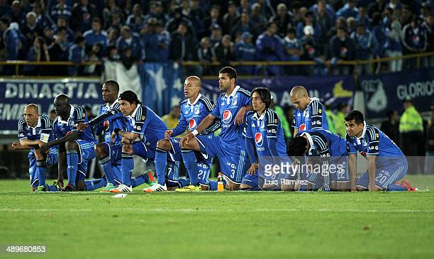 Players of Millonarios during a match between Millonarios FC and Atletico Junior as part of the second leg of the Liga Postobon 2014 at Nemesio...