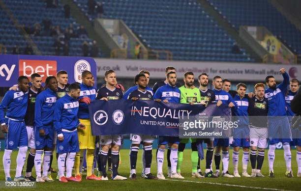 Players of Millwall and Queens Park Rangers pose with a banner against inequality prior to the Sky Bet Championship match between Millwall and Queens...
