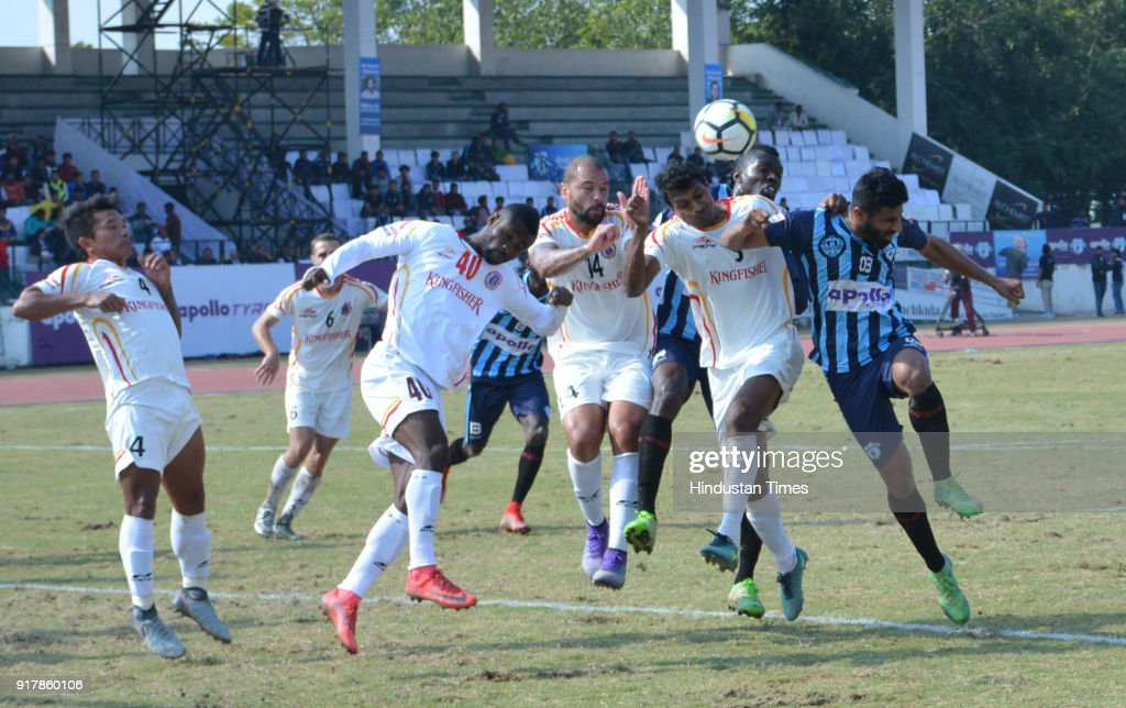 Players of Minerva Punjab FC and East Bengal tussle for the ball in an ILeague match at Tau Devi Lal Stadium on February 13 2018 in Panchkula India...