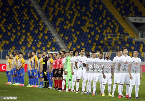 Players of MKE Ankaragucu and Caykur Rizespor stand in silence ahead of the Turkish Super Lig soccer match between MKE Ankaragucu and Caykur...