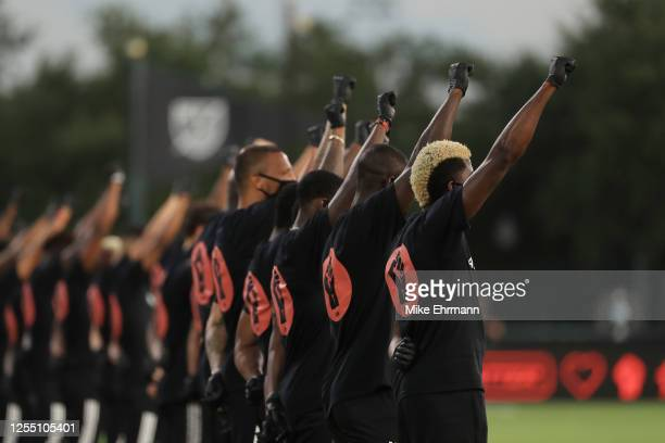 Players of MLS teams participate in a Black Lives Matter pre-game ceremony before match between Orlando City and Inter Miami as part of MLS is back...