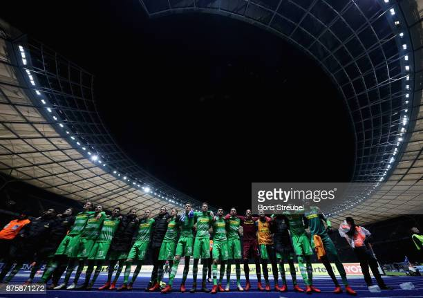 Players of Moenchengladbach celebrate in front of their supporters after the Bundesliga match between Hertha BSC and Borussia Moenchengladbach at...