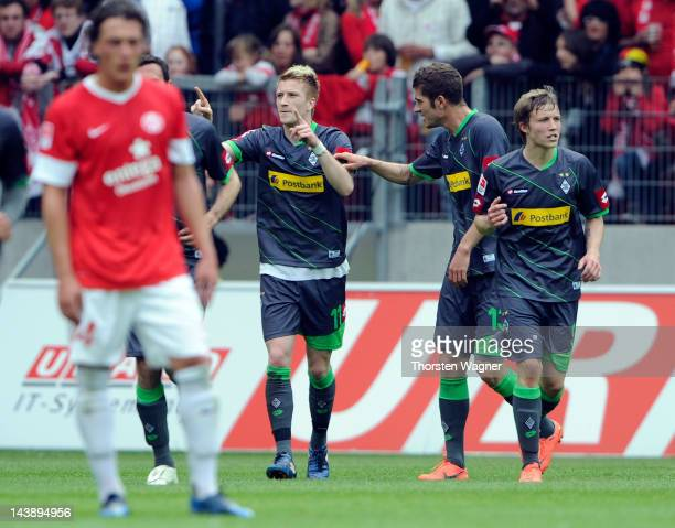 Players of Moenchengladbach celebrates after Marco Reus is scoring his teams first goal during the Bundesliga match between FSV Mainz 05 and Borussia...