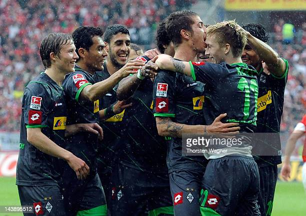 Players of Moenchengladbach celebrates after Marco Reus is scoring his teams second goal during the Bundesliga match between FSV Mainz 05 and...