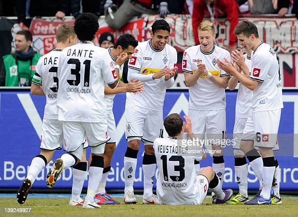 Players of Moenchengladbach celebrates after Roman Neustaedter is scoring his teams first goal during the Bundesliga match between 1FC Kaiserslautern...