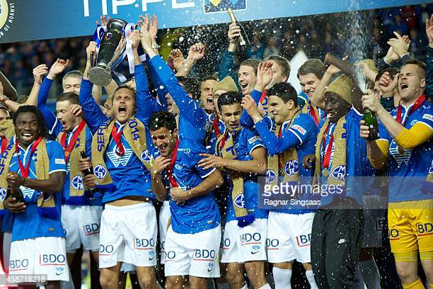 Players of Molde FK celebrate victory after winning the Tippeligaen 2014 on November 9 2014 in Molde Norway