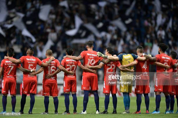 Players of Monterrey and Veracruz pay homage to Diana González, player of America women's team who passed away recently, prior the 17th round match...