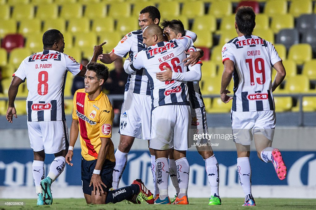 Players of Monterrey celebrate the first goal of the game during a match between Morelia and Monterrey as part of 15th round Apertura 2014 Liga MX at Jose Maria Morelos y Pavon Stadium on October 31, 2014 in Morelia, Mexico.