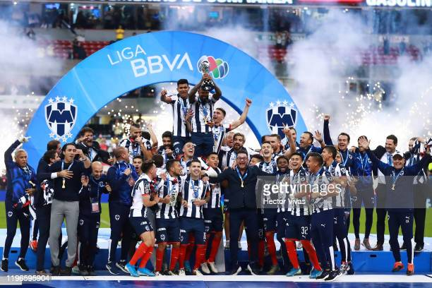 Players of Monterrey celebrate with the champions trophy after winningthe Final second leg match between America and Monterrey as part of the Torneo...