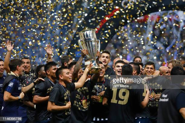 Players of Monterrey celebrate with the trophy after the final second leg match between Monterrey and Tigres UANL as part of the CONCACAF Champions...