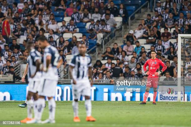 Players of Monterrey react after Lucas Cavallini of Puebla scored the third goal of his team during the 10th round match between Monterrey and Puebla...