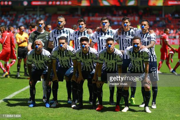 Players of Monterrey wear a blue nose to create awareness over autism prior the 13th round match between Toluca and Monterrey as part of the Torneo...
