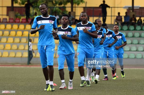 Players of Mountain of Fire and Miracles Ministries football club train before a CAF Confederation Cup playoff match bat the Agege Stadium in Lagos...