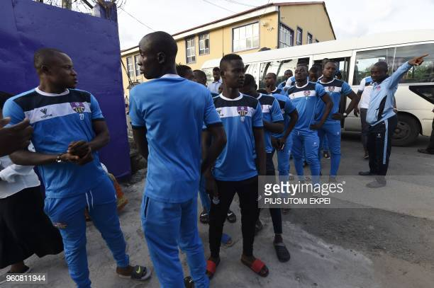 Players of Mountain of Fire and Miracles Ministries football club step out from bus to pray in the church at the international headquaters in Yaba...