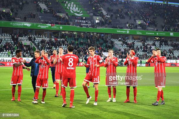 Players of Muenchen celebrate after the Bundesliga match between VfL Wolfsburg and FC Bayern Muenchen at Volkswagen Arena on February 17 2018 in...
