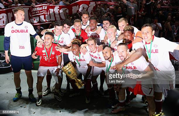 Players of Muenchen celebrate after winning the DFB Cup Final 2016 between Bayern Muenchen and Borussia Dortmund at Olympiastadion on May 21 2016 in...