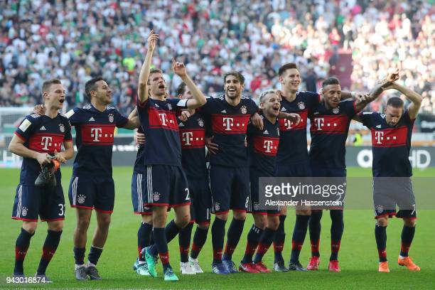 Players of Muenchen celebrate in front of their supporters winning the Bundesliga championship during the Bundesliga match between FC Augsburg and FC...