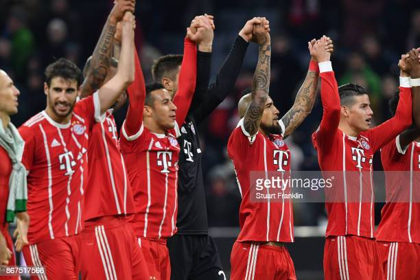Players of Muenchen celebrate including Arturo Vidal of Bayern Muenchen and James Rodriguez of Bayern Muenchen after the Bundesliga match between FC...