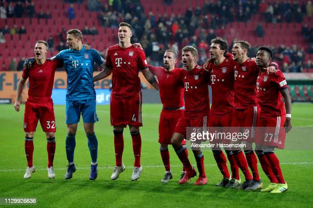 Players of Muenchen celebrate victory after the Bundesliga match between FC Augsburg and FC Bayern Muenchen at WWKArena on February 15 2019 in...
