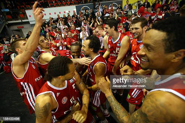 Players of Muenchen celebrate victory with their supporters after winning the Beko Basketball match between FC Bayern Muenchen and Walter Tigers...