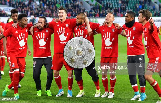 Players of Muenchen celebrate winning the Bundesliga title after the Bundesliga match between VfL Wolfsburg and Bayern Muenchen at Volkswagen Arena...