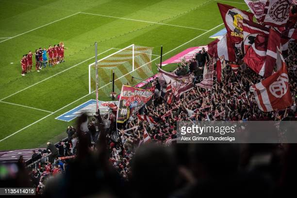 Players of Muenchen celebrate with the fans after the Bundesliga match between FC Bayern Muenchen and Borussia Dortmund at Allianz Arena on April 06...