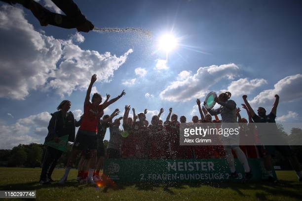 Players of Muenchen celebrate with the trophy after winning the title after the 2 Frauen Bundesliga match between TSG 1899 Hoffenheim II and FC...