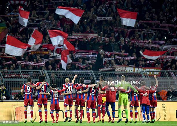 Players of Muenchen celebrate with their fans after winning the Bundesliga match between Borussia Dortmund and FC Bayern Muenchen at Signal Iduna...