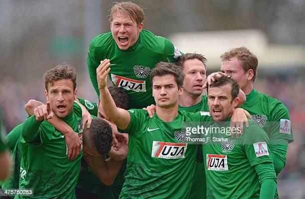 Players of Muenster celebrate their teams first goal during the Third League match between Preussen Muenster and VfL Osnabrueck at Preussenstadion on...
