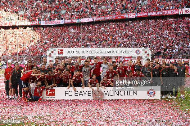 Players of Munechen and staff pose with the champions trophy after the Bundesliga match between FC Bayern Muenchen and VfB Stuttgart at Allianz Arena...
