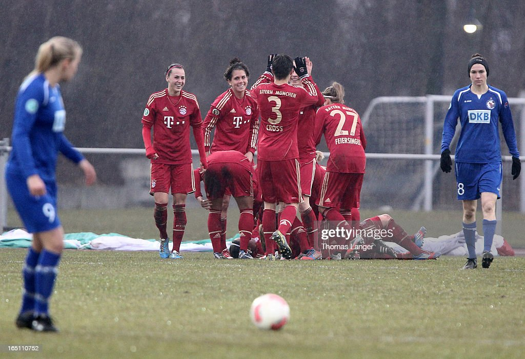 Players of Munich (C) celebrate after Lena Lotzens 1-0 goal during the Women's Soccer Bundesliga Match between Bayern Muenchen and 1. FFC Turbine Potsdam on March 30, 2012 in Aschheim, Germany.