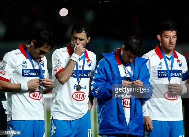 Players of Nacional at the end of the second leg final match between San Lorenzo and Nacional as part of Copa Bridgestone Libertadores 2014 at Pedro...