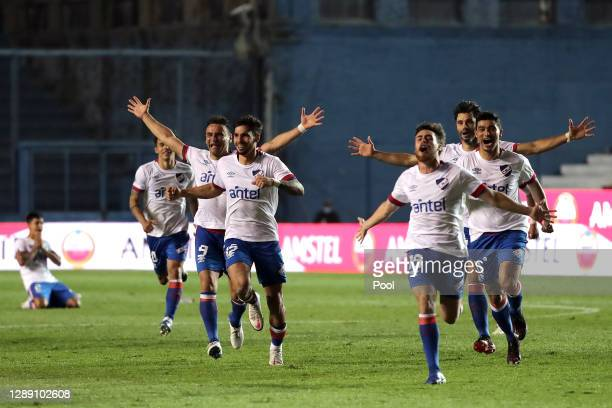 Players of Nacional celebrate after defeating Independiente del Valle in the penalty shootout during a round of sixteen second leg match of Copa...