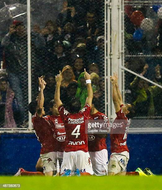 Players of Nacional celebrate their team's first goal during the match between Velez Sarsfield and Nacional as part of round sixteen of Copa...