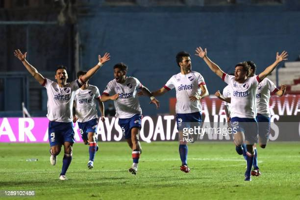 Players of Nacional celebrates defeating Independiente del Valle in the penalty shootout during a round of sixteen second leg match of Copa CONMEBOL...