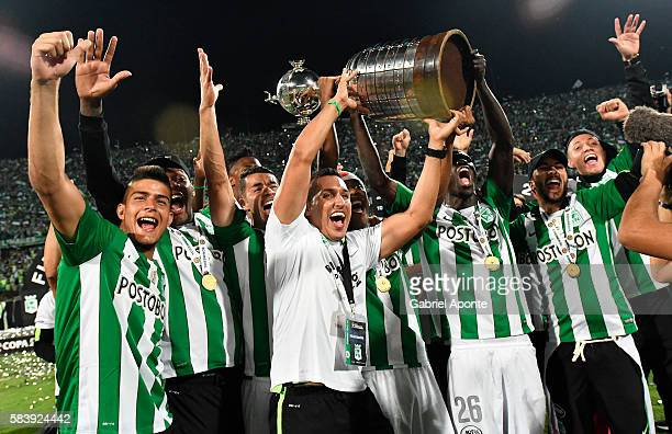 Players of Nacional lift the trophy to celebrate as champions of the Copa Libertadores 2016 after a second leg final match between Atletico Nacional...