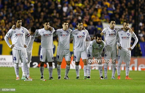 Players of Nacional observe the penalty series during a second leg match between Boca Juniors and Nacional as part of quarter finals of Copa...