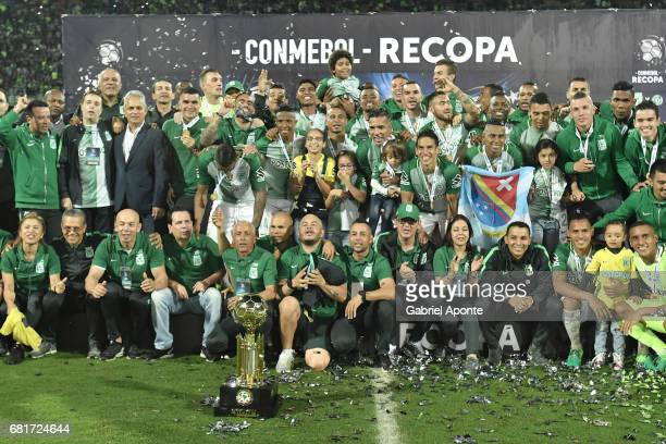 Players of Nacional pose for a group photo with the trophy after winning a match between Atletico Nacional and Chapecoense as part of CONMEBOL Recopa...