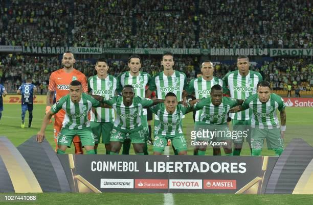 Players of Nacional pose prior a round of sixteen match between Atletico Nacional and Atletico Tucuman as part of Copa CONMEBOL Libertadores 2018 at...