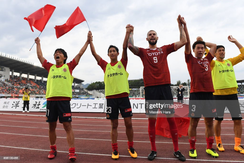 Players of Nagoya Grampus celebrate the win after the J.League J2 match between FC GIfu and Nagoya Grampus at Nagaragawa Stadium on October 1, 2017 in Gifu, Japan.